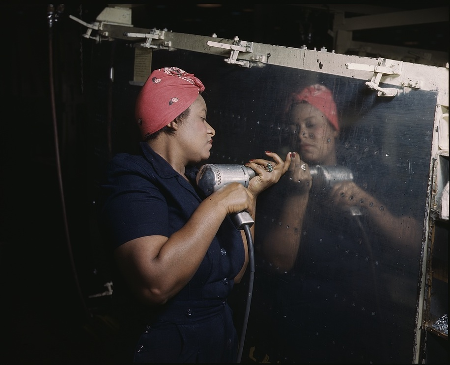 Woman working on airplane